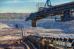 Long conveyor belt transporting ore Stock Photos