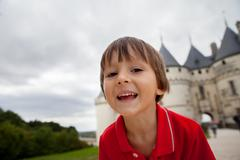 Portrait of a child in front of Chaumont castle - stock photo