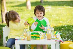 Happy sweet preschool children, celebrating fifth birthday of cute boy - stock photo