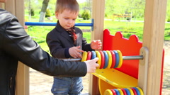 Little Boy Playing With An Abacus. Children's park - stock footage