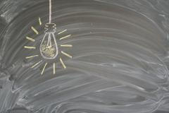 Idea concept with light bulb Stock Photos
