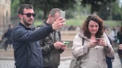 Rome Antique Site, Coliseum, turist make photo selfie via Mobile phone Stock Footage
