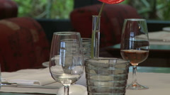 Waitress refills the glass with red madeira wine in a restaurant. - stock footage