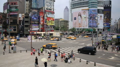 People walking on the pedestrian crossing around the popular Ximending Stock Footage
