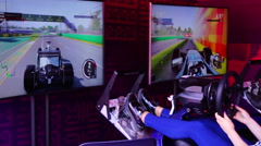 A girl riding on the simulator car racing rally Arkistovideo