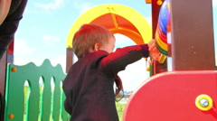 Little Boy Playing With An Abacus. Children's park Stock Footage