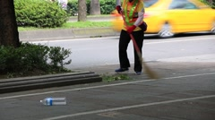 Public janitor cleaning street around Ximending district in Taipei, Taiwan Stock Footage