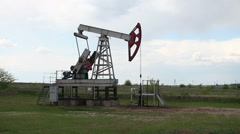 Oil and gas industry. Work of oil pump jack on a oil field. - stock footage