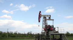 Oil rocking working in the field Stock Footage