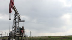 Oil Well in the Field Pumping Stock Footage