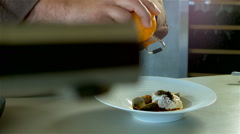Gourmet cooking bass fish with clams: plating of food. Stock Footage