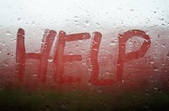 "The ""Help"" inscription on the sweaty glass Stock Photos"