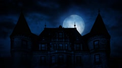 Large Moon Rises Behind Scary Mansion Stock Footage