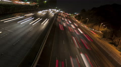4K Time lapse rotate freeway light trails at night Stock Footage