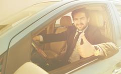 Businessman driving car Stock Photos