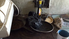 Unpleasant place with a rusty plate and other objects Stock Footage