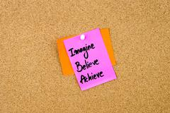 Imagine Believe Achieve written on paper note - stock photo
