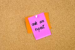Ask An Expert written on paper note Stock Photos