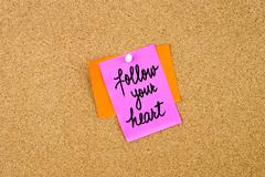 Follow Your Heart written on paper note Stock Photos