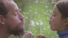 Portrait of a father and son with a flower dandelion. Stock Footage