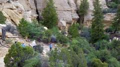 Hikers on desert mountain trail San Rafael Utah 4K Stock Footage
