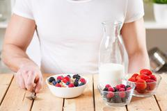Healthy and nutritious yogurt with cereal and fresh raw berries - stock photo