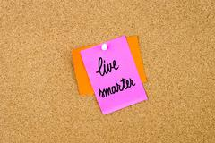 Live Smarter written on paper note Stock Photos