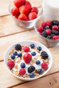 Healthy and nutritious yogurt with cereal and fresh raw berries Stock Photos