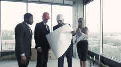 Group of designers presents their project of furnish this office space to the Stock Footage