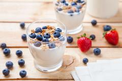 Nutritious and healthy yogurt with blueberries and cereal - stock photo