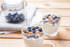 Nutritious and healthy yogurt with blueberries and cereal Stock Photos