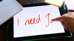 I need job. Written on white on tablet. - stock footage