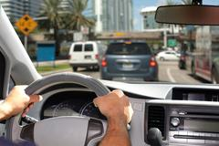 Hands of man with steering wheel. - stock photo