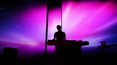 Silhouette of DJ is standing with his turntable and other equipment Stock Footage