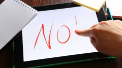 """""""No"""" on tablet with white background, disagreement Stock Footage"""