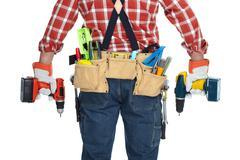 Builder handyman with drill. Stock Photos