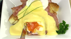 Slicing Eggs Benedict With A Knife Stock Footage