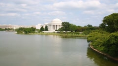 Jefferson memorial with a big pond and trees at Washington Stock Footage