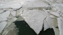 Cracked ice floating on river at spring, aerial Stock Footage
