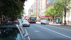 Firetruck is going on the street and people record it to phones. - stock footage
