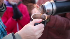 Close up view of the black thermos and cup with a hand. Stock Footage