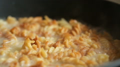 Dish with macaroni in a pan boils - stock footage
