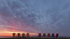4K Time lapse Red Sunrise behind Chairs Stock Footage