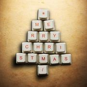 Christmas tree made of computer keys, Old paper background Kuvituskuvat