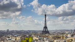 Eiffel Tower, elevated aerial view over rooftops, Paris, France Stock Footage