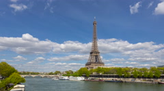 Tour boat on Seine River passing the Eiffel Tower, Paris, France Stock Footage