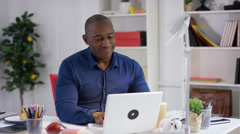 4K Businessman working at his desk in office stretching to relieve muscle tensio - stock footage