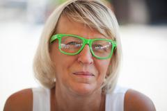 Middle-aged woman wearing trendy eyeglasses Stock Photos