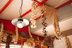 Garlic and Peppers Hanging from Ceiling In Market Stock Photos