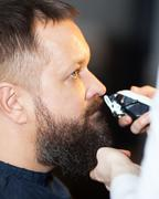Man having his mustache trimmed at a barber Stock Photos